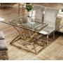 Table de salle à manger design piètement en acier inoxydable poli doré et plateau en verre trempé transparent  L. 180 x P. 90 x H. 75 cm collection PARMA