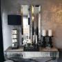 Console design plateau et contour en miroir avec un piètement croisée en acier inoxydable poli  L. 120 x P. 40 x H. 75 cm collection GALA